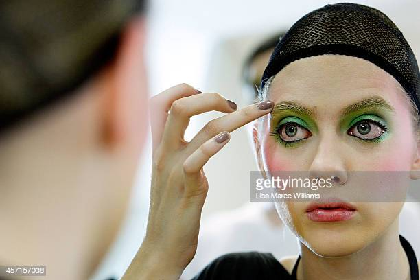 A model prepares backstage ahead of the DRESSCAMP show as part of Mercedes Benz Fashion Week TOKYO 2015 S/S at Shibuya Hikarie on October 13 2014 in...