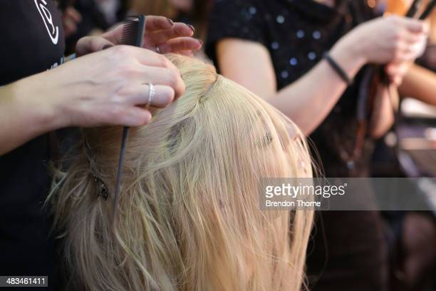 A model prepares backstage ahead of the Duvenage show at MercedesBenz Fashion Week Australia 2014 at Carriageworks on April 9 2014 in Sydney Australia