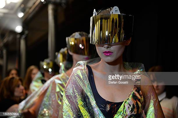 A model prepares backstage ahead of the Fashion Week Highlight Show as part of Mercedes Benz Fashion Festival Sydney 2012 at Sydney Town Hall on...