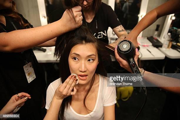 A model prepares backstage ahead of the Gary Bigeni show at MercedesBenz Fashion Week Australia 2015 at Carriageworks on April 13 2015 in Sydney...