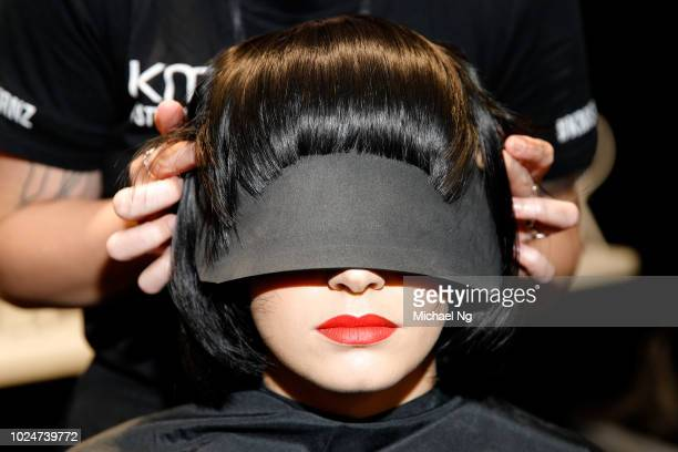 A model prepares backstage ahead of the Hailwood show during New Zealand Fashion Week 2018 at Viaduct Events Centre on August 28 2018 in Auckland New...
