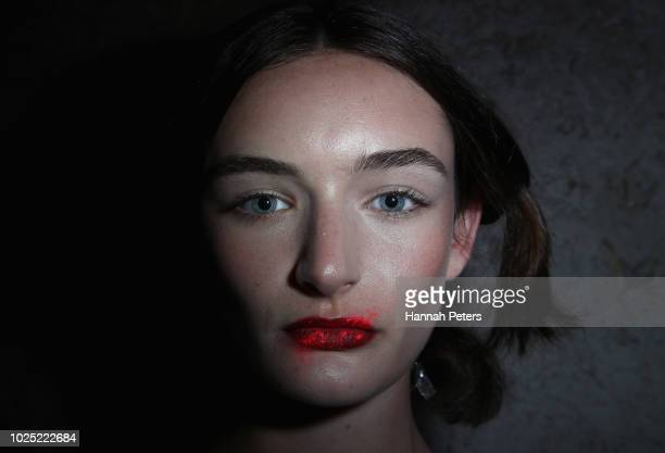 A model prepares backstage ahead of the Huffer show during New Zealand Fashion Week 2018 at The Powerstation on August 30 2018 in Auckland New Zealand