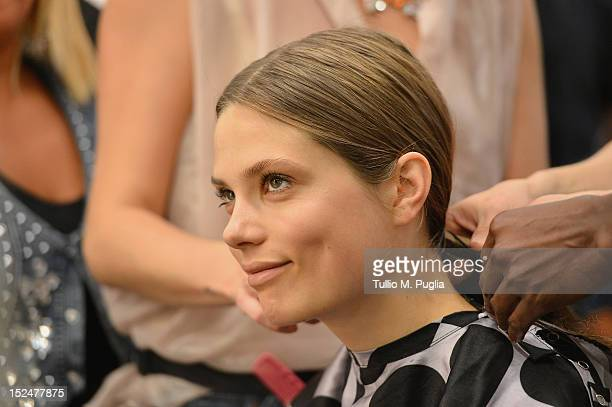 Model prepares backstage ahead of the Iceberg Spring/Summer 2013 fashion show as part of Milan Womenswear Fashion Week on September 21, 2012 in...