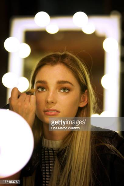 A model prepares backstage ahead of the InStyle Red Carpet Runway show during MercedesBenz Fashion Festival Sydney 2013 at Sydney Town Hall on August...