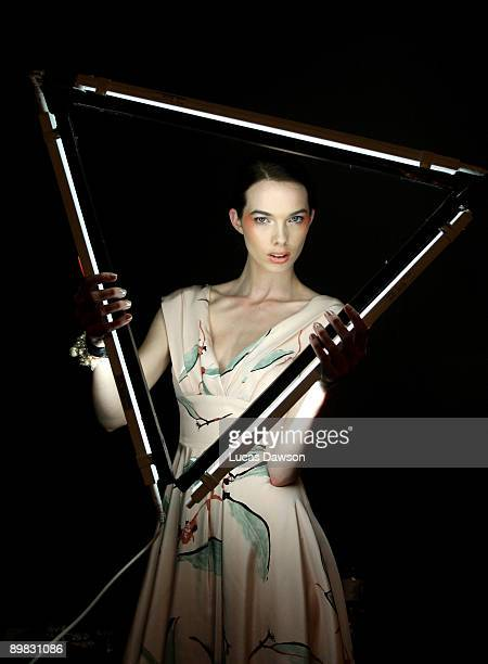 Model prepares backstage ahead of the Jayson Brunsdon Gala Opening night show at Rosemount Sydney Fashion Festival 2009 at Martin Place on August 17,...