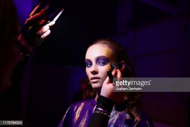A model prepares backstage ahead of the Jojo Ross show during New Zealand Fashion Week 2019 at Auckland Town Hall on August 27 2019 in Auckland New...