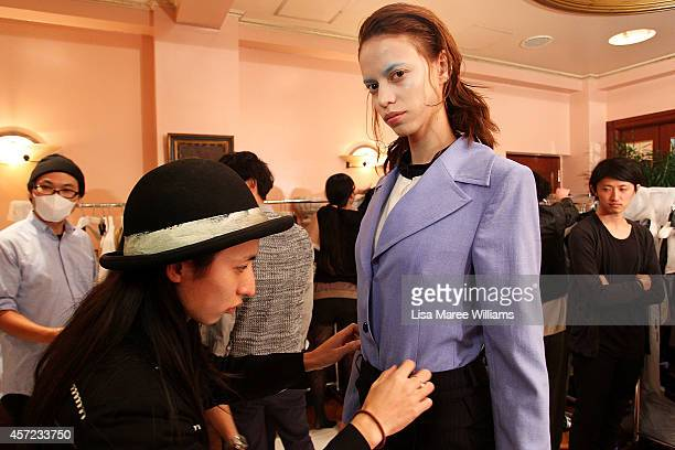 A model prepares backstage ahead of the LAMARCK show as part of Mercedes Benz Fashion Week TOKYO 2015 S/S at RISTORANTE ASO on October 15 2014 in...