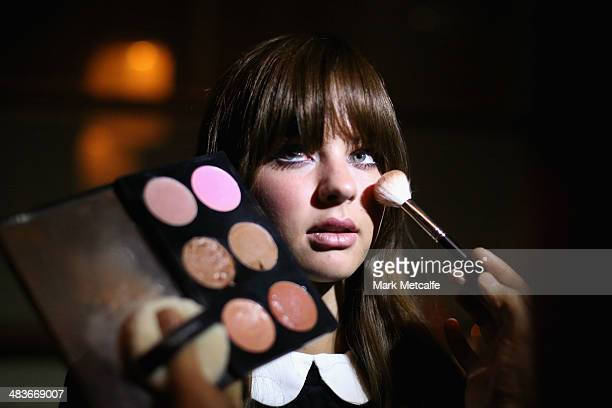 A model prepares backstage ahead of the MacGraw show at MercedesBenz Fashion Week Australia 2014 at Carriageworks on April 10 2014 in Sydney Australia