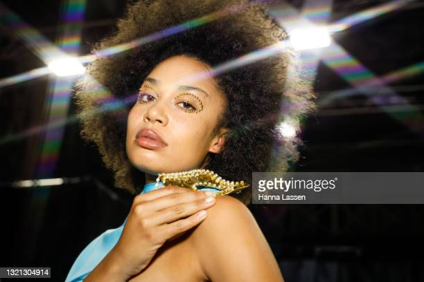 Model prepares backstage ahead of the Mariam Seddiq show during Afterpay Australian Fashion Week 2021 Resort '22 Collections at Carriageworks on June...
