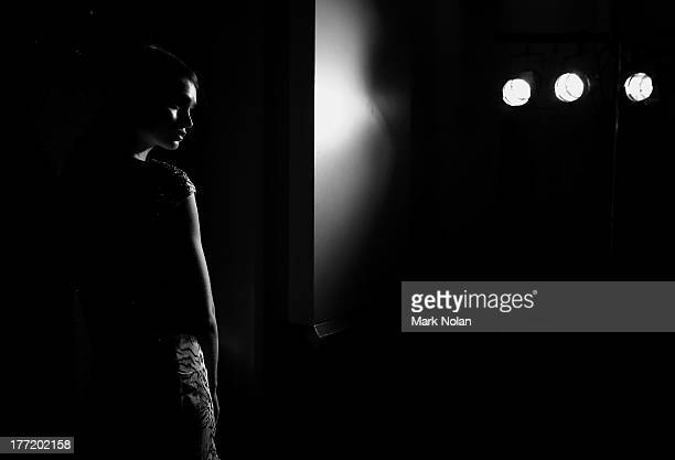 A model prepares backstage ahead of the MBFWA Trends show during MercedesBenz Fashion Festival Sydney 2013 at Sydney Town Hall on August 22 2013 in...