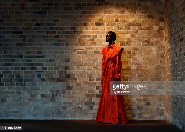 Model prepares backstage ahead of the Mercedes-Benz Presents Aje show at Mercedes-Benz Fashion Week Resort 20 Collections at Campbell's Stores on May...