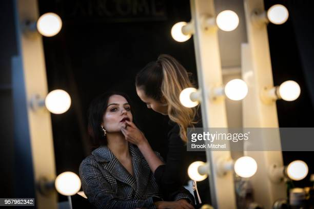 A model prepares backstage ahead of the MercedesBenz Presents Camilla And Marc show at MercedesBenz Fashion Week Resort 19 Collections at the Royal...