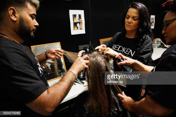 A model prepares backstage ahead of the MercedesBenz Presents Knuefermann show during New Zealand Fashion Week 2018 at Viaduct Events Centre on...