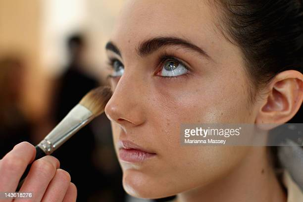 A model prepares backstage ahead of the Michael Lo Sordo show on day two of MercedesBenz Fashion Week Australia Spring/Summer 2012/13 at The Apollo...