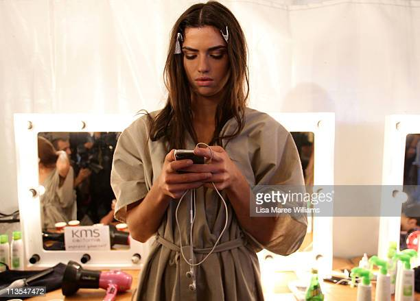 A model prepares backstage ahead of the Nookie Beach show during Rosemount Australian Fashion Week Spring/Summer 2011/12 at Overseas Passenger...