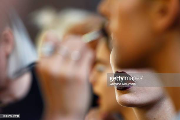 A model prepares backstage ahead of the Phoenix Keating show during MercedesBenz Fashion Week Australia Spring/Summer 2013/14 at Carriageworks on...