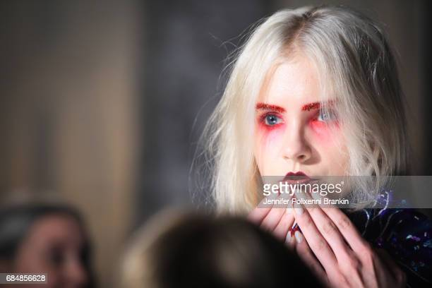 A model prepares backstage ahead of the Romance Was Born show at MercedesBenz Fashion Week Resort 18 Collections at Carriageworks on May 18 2017 in...