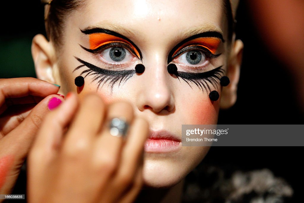 A model prepares backstage ahead of the Romance Was Born show during Mercedes-Benz Fashion Week Australia Spring/Summer 2013/14 at Carriageworks on April 8, 2013 in Sydney, Australia.