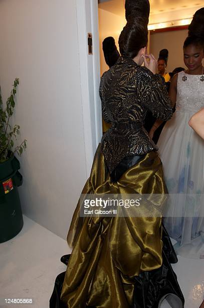 Model prepares backstage ahead of the Saint Wobil - Darius Wobil Spring 2012 fashion show during Mercedes-Benz Fashion Week at Studio 450 on...
