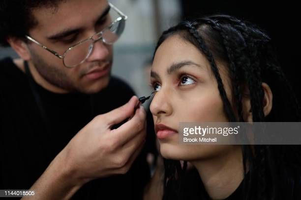A model prepares backstage ahead of the StGeorge NextGen show at MercedesBenz Fashion Week Resort 20 Collections at Carriageworks on May 16 2019 in...