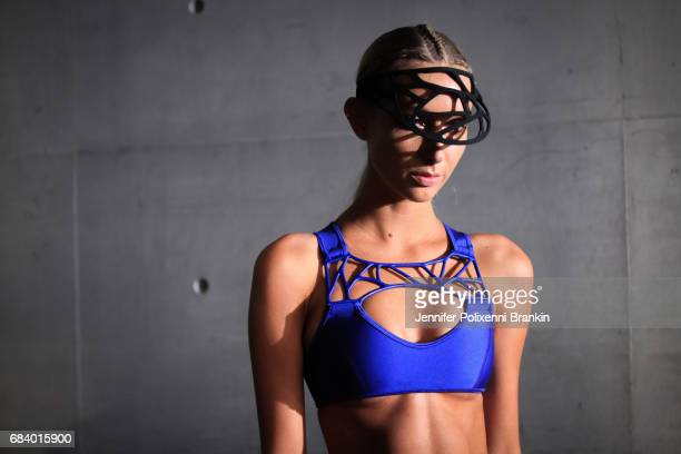 A model prepares backstage ahead of the The Innovators Fashion Design Studio show at MercedesBenz Fashion Week Resort 18 Collections at Carriageworks...