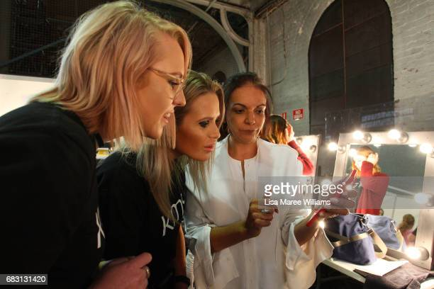 A model prepares backstage ahead of the Thomas Puttick show at MercedesBenz Fashion Week Resort 18 Collections at Carriageworks on May 15 2017 in...