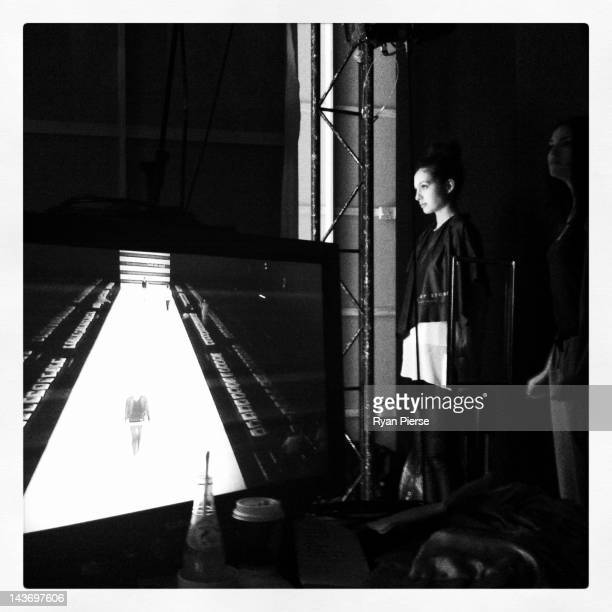 Model prepares backstage ahead of the Toi Et Moi Sydney show on day two of Mercedes-Benz Fashion Week Australia Spring/Summer 2012/13 at Overseas...
