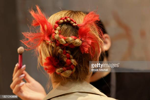 Model prepares backstage ahead of the Yousef Akbar show during Afterpay Australian Fashion Week 2021 Resort '22 Collections at Carriageworks on June...