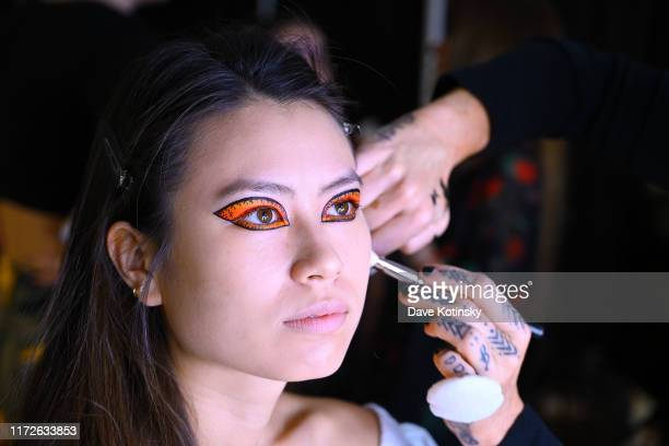 A model prepares backstage as Cheetos unveiled faninspired versions of the #CheetosFlaminHaute look at The House Of Flamin' Haute Runway Show Style...