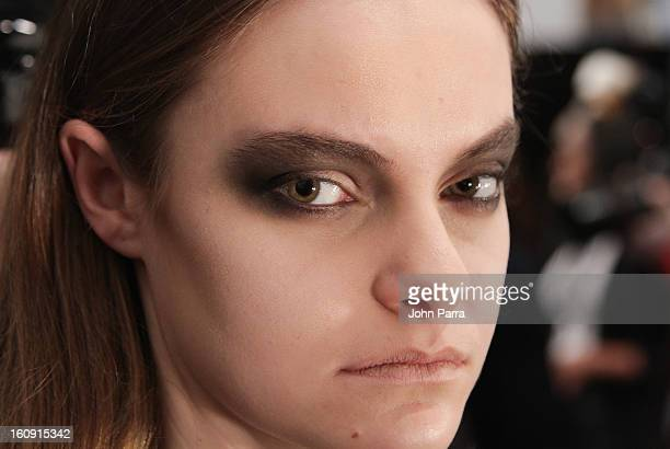 A model prepares backstage as NYX Cosmetics is the Official Makeup Sponsor of Nicholas K Fall/Winter 2013 Show with Lead Makeup Artist Tina Turnbow...