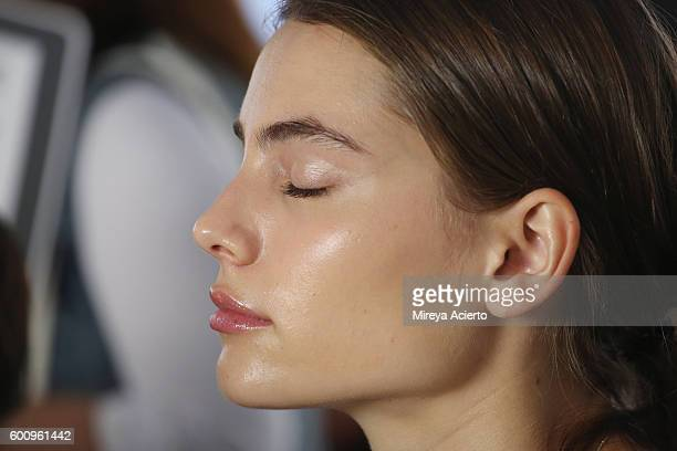 A model prepares backstage at Brock Collection fashion show during MADE Fashion Week September 2016 at Milk Studios on September 8 2016 in New York...