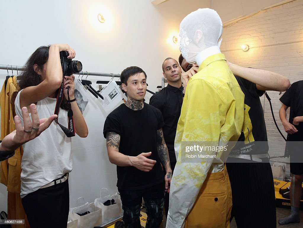 A model prepares backstage at Kenneth Ning Presentation during New York Fashion Week: Men's S/S 2016at Industria Superstudio on July 13, 2015 in New York City.