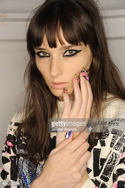A model prepares backstage at Libertine Spring/Summer 2017 fashion show during NEw York Fashion Week on September 12 2016 in New York City