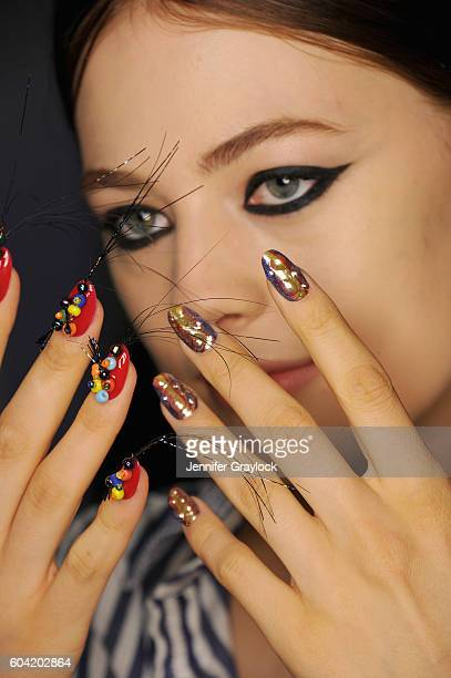 Model prepares backstage at Libertine Spring/Summer 2017 fashion show during NEw York Fashion Week on September 12, 2016 in New York City.