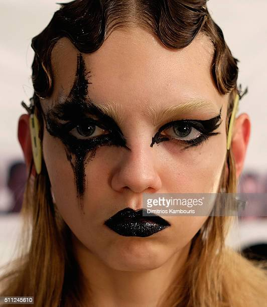 A model prepares backstage at Marc Jacobs Fall 2016 fashion show during new York Fashion Week at Park Avenue Armory on February 18 2016 in New York...