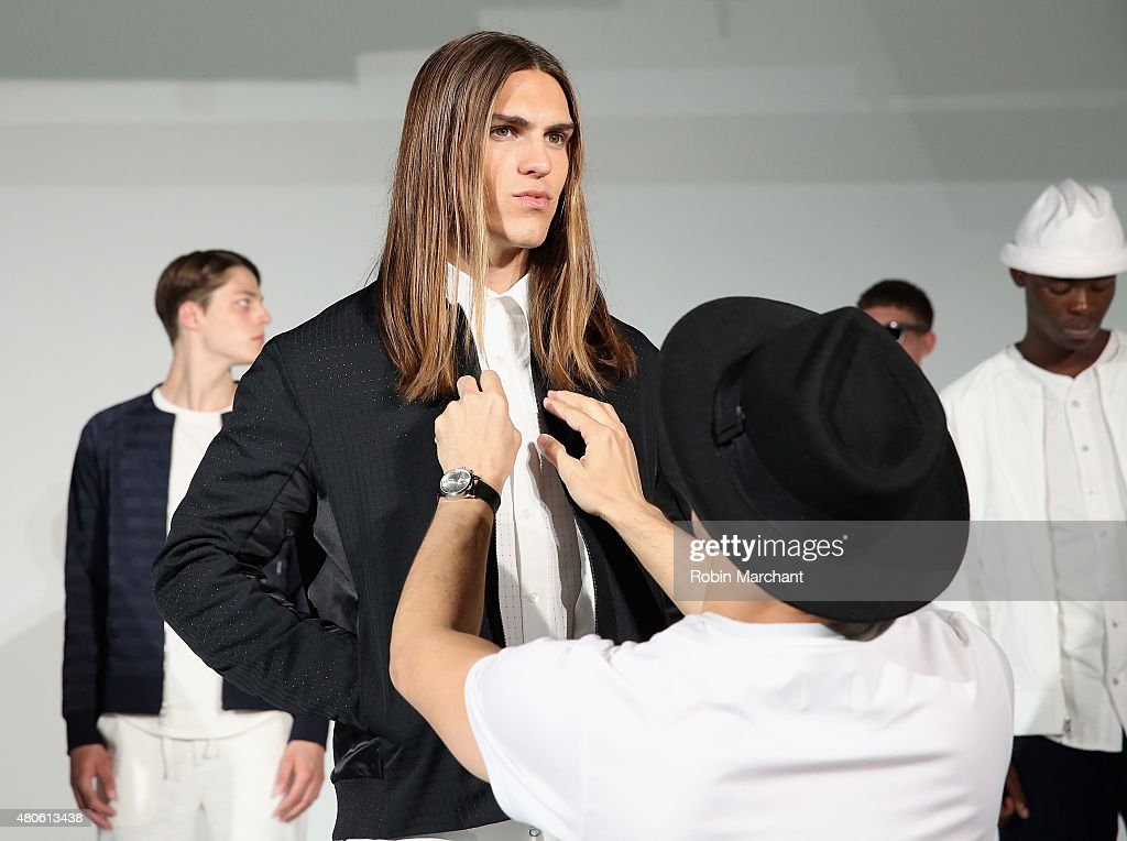A model prepares backstage at Matiere Presentation during New York Fashion Week: Men's S/S 2016 at Industria Superstudio on July 13, 2015 in New York City.