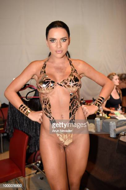 A model prepares backstage at Miami Swim Week powered by Art Hearts Fashion Swim/Resort 2018/19 at Faena Forum on July 15 2018 in Miami Beach Florida