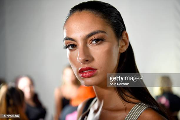 A model prepares backstage at Miami Swim Week powered by Art Hearts Fashion Swim/Resort 2018/19 at Faena Forum on July 12 2018 in Miami Beach Florida