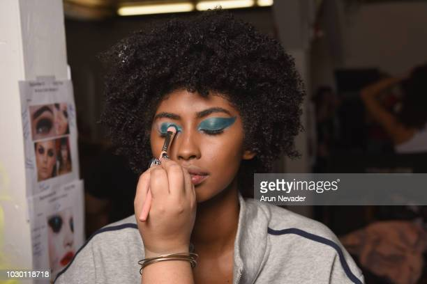 A model prepares backstage at New York Fashion Week Powered By Art Hearts Fashion at The Angel Orensanz Foundation on September 9 2018 in New York...