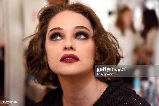 A model prepares backstage at New York Fashion Week Powered by Art Hearts Fashion NYFW at The Angel Orensanz Foundation on February 10 2018 in New...