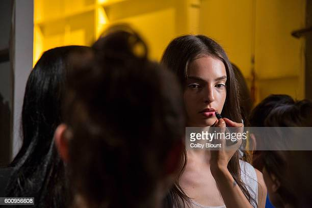 A model prepares backstage at Noon by Noor fashion show during New York Fashion Week The Gallery Skylight at Clarkson Sq on September 8 2016 in New...