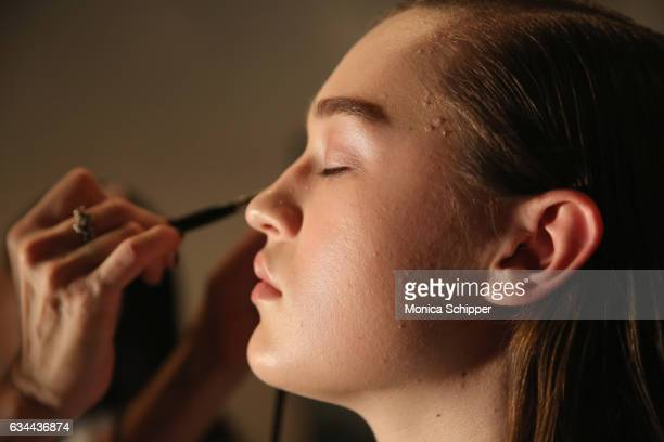 A model prepares backstage at Noon by Noor fashion show during New York Fashion Week The Shows at Gallery 3 Skylight Clarkson Sq on February 9 2017...