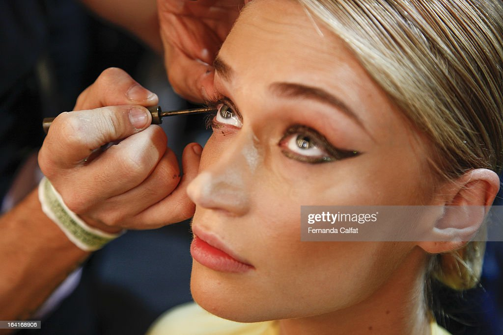 A model prepares backstage at the Agua de Coco show during Sao Paulo Fashion Week Summer 2013/2014 on March 20, 2013 in Sao Paulo, Brazil.