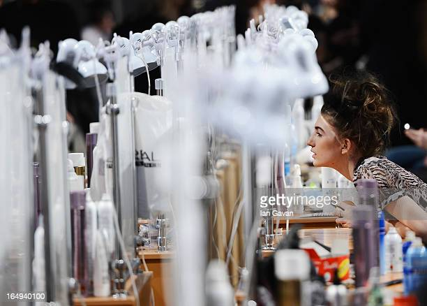 A model prepares backstage at the Alena Akhmadullina show during MercedesBenz Fashion Week Russia Fall/Winter 2013/2014 at Manege on March 29 2013 in...