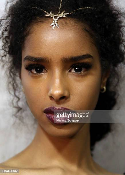 A model prepares backstage at the Ane Amour fashion show during New York Fashion Week at Pier 59 on February 9 2017 in New York City