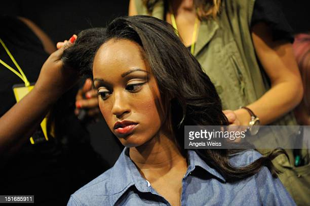A model prepares backstage at the Anna Francesca Spring 2013 fashion show during MercedesBenz Fashion Week at Helen Mills Event Space on September 9...