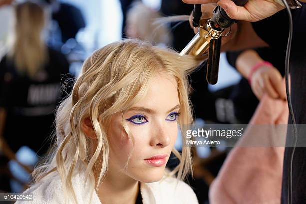 A model prepares backstage at the Anna K fashion show during Fall 2016 MADE Fashion Week at Milk Studios on February 15 2016 in New York City
