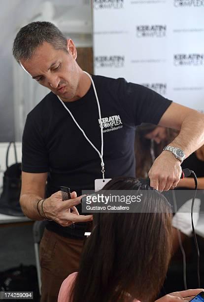 A model prepares backstage at the Anna Kosturova/Beach Riot/Lolli Swim/Manglar/Indah show at MercedesBenz Fashion Week Swim 2014 at Cabana Grande at...
