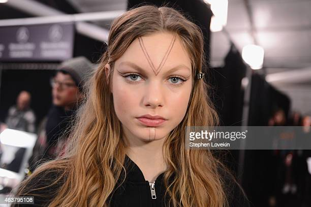 A model prepares backstage at the Anna Sui fashion show during MercedesBenz Fashion Week Fall 2015 at The Theatre at Lincoln Center on February 18...