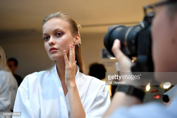 A model prepares backstage at the Badgley Mischka show during New York Fashion Week The Shows at Gallery I at Spring Studios on September 8 2018 in...